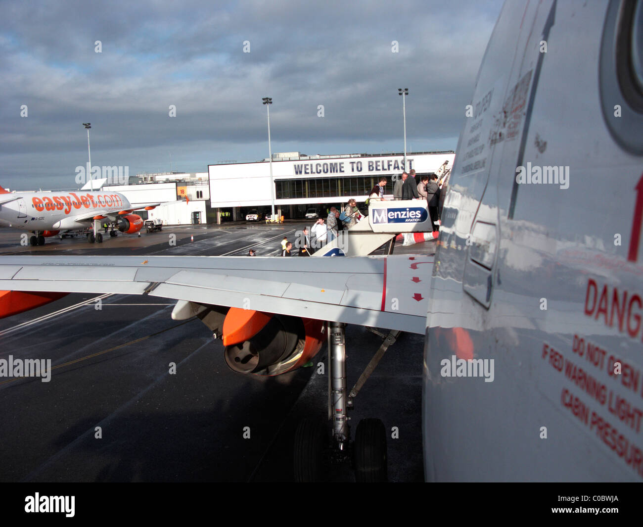 passengers boarding easyjet a319 airbus aircraft at Belfast International Airport - Stock Image