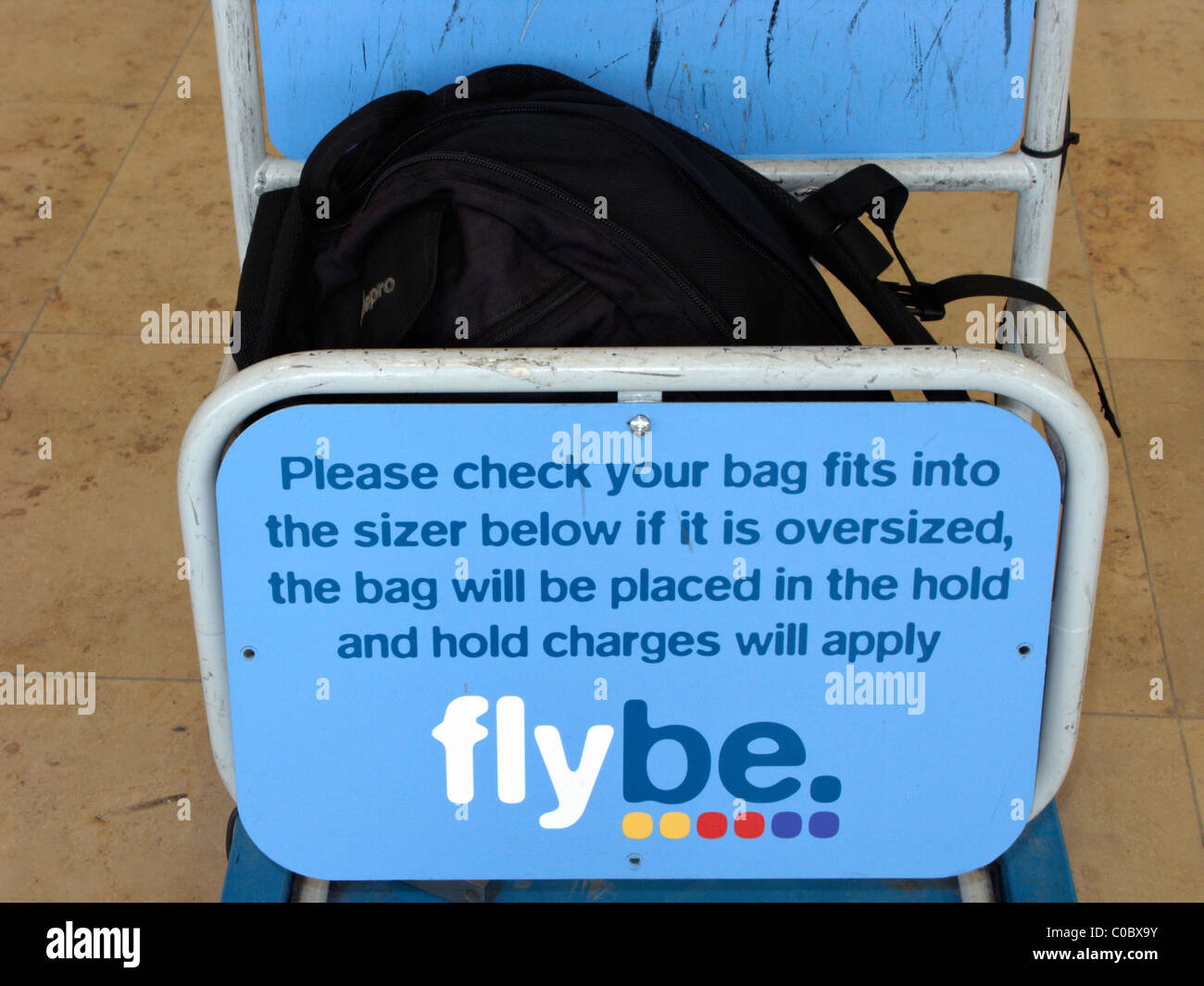 oversized bag in flybe cabin baggage size gauge at airport - Stock Image