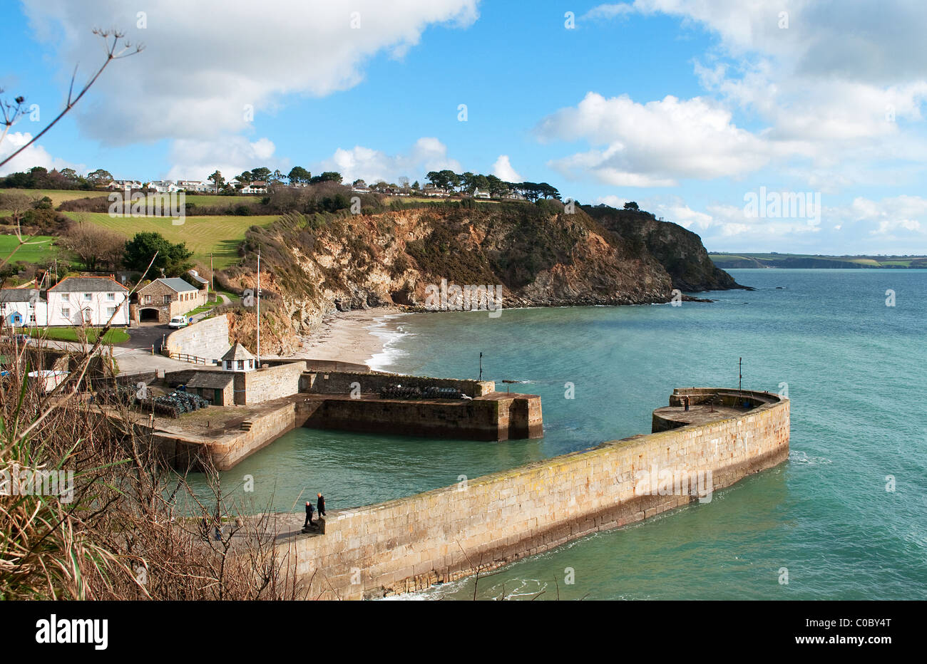 The entrance the georgian harbour at Charlestown in Cornwall, UK - Stock Image