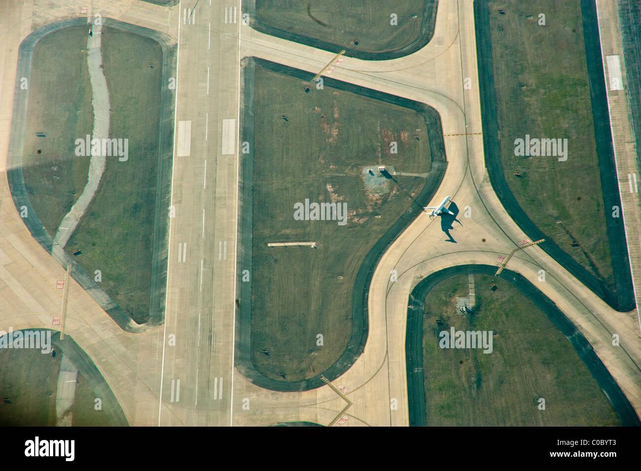 An aerial photograph of a jet taxiing on the tarmac at Atlanta's Hartsfield-Jackson Airport after landing. - Stock Image