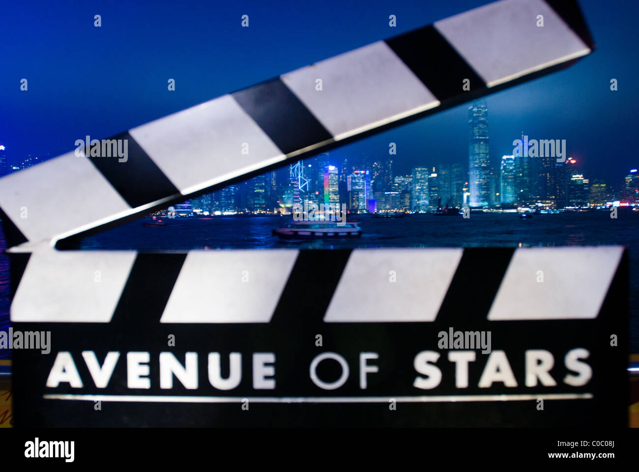 Clack board on Avenue of Stars in Hong Kong with the Sky Scrapers in the background - Stock Image