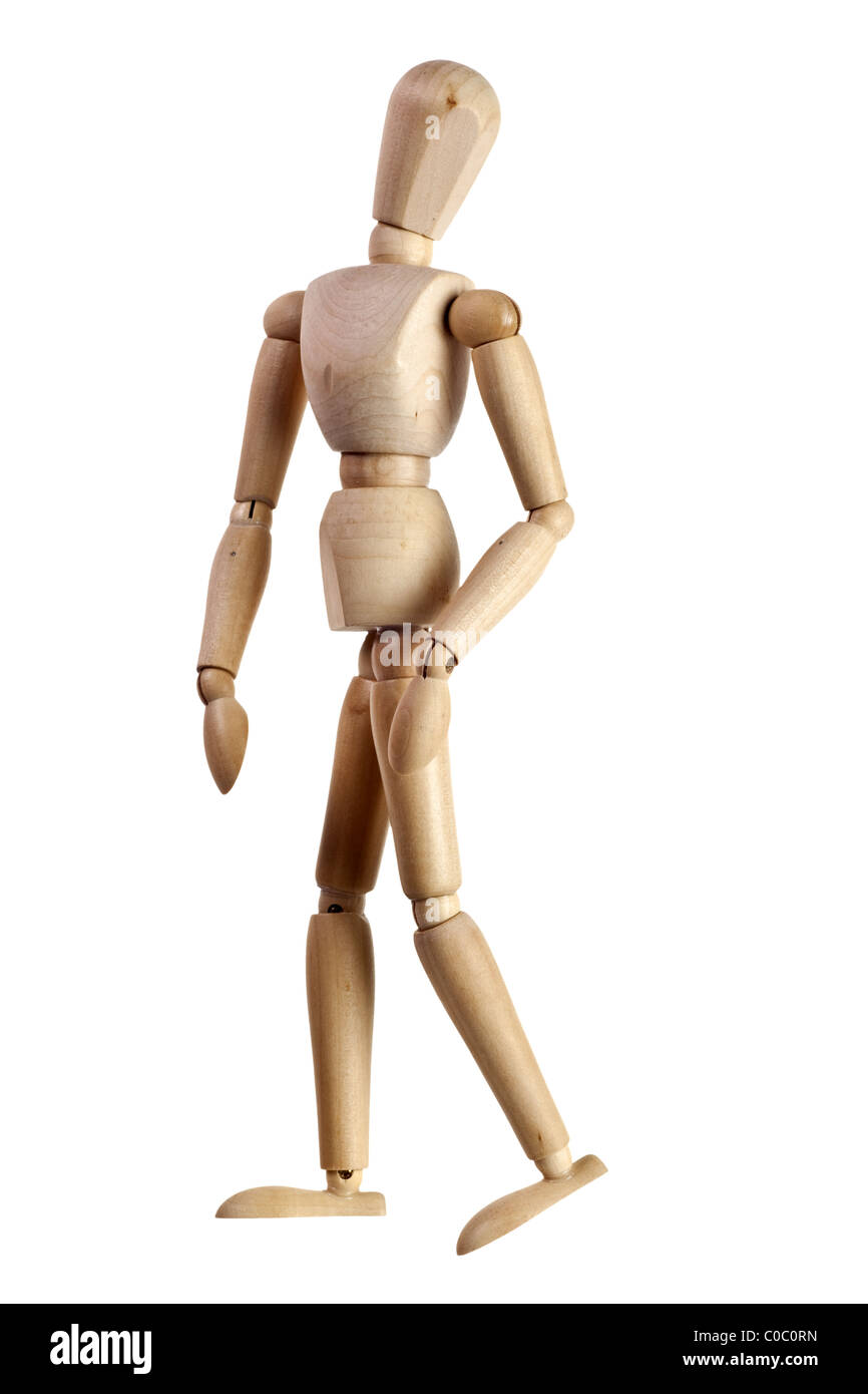 Wooden mannequin looking over its shoulder isolated on white background - Stock Image