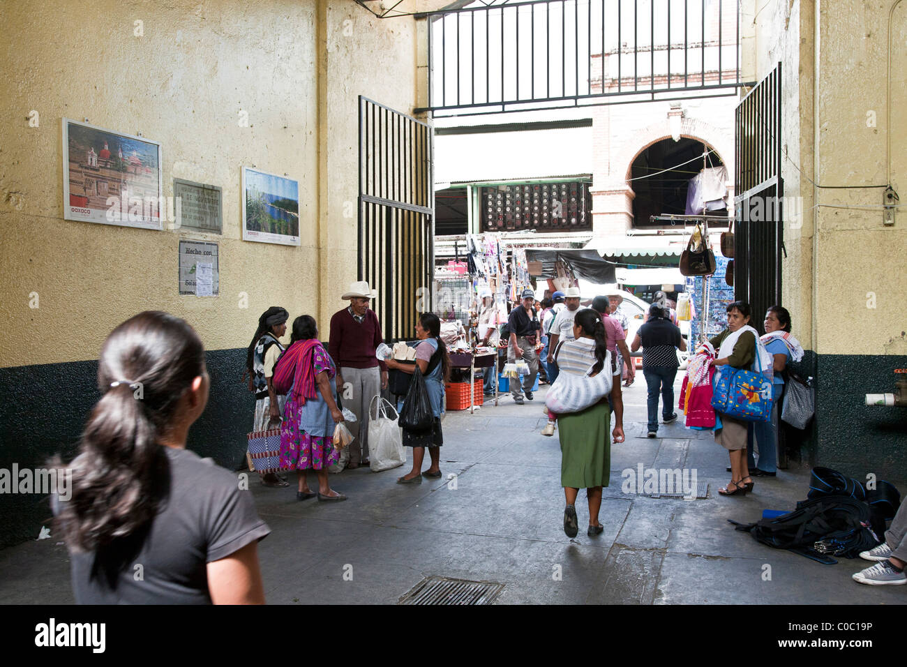 lively entrance to 20 November 20th market bustling with foot traffic customers & indigenous Indian vendors - Stock Image
