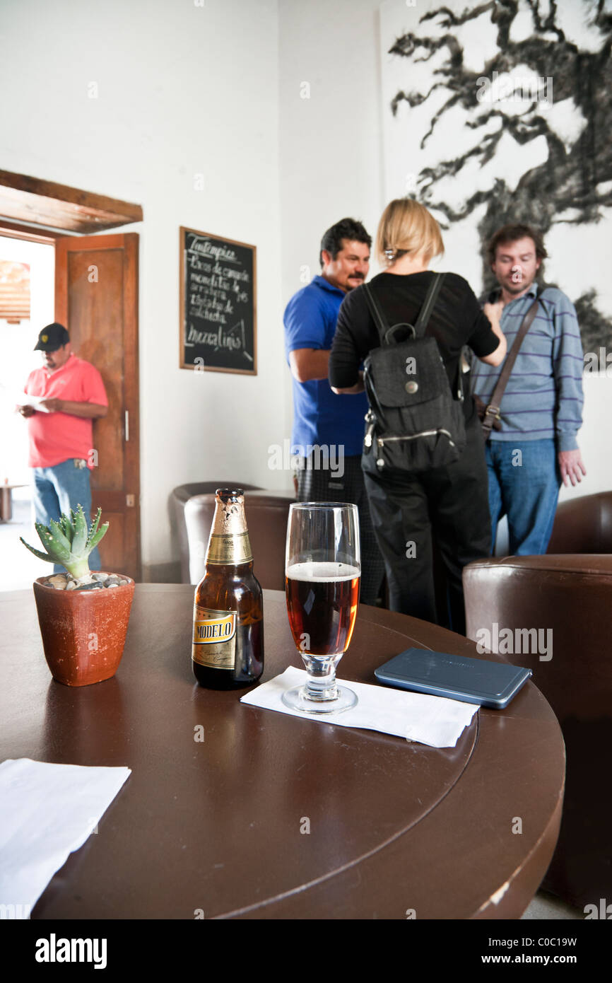 delicious cold dark beer on table of convivial upscale bar in Oaxaca City Oaxaca State Mexico - Stock Image