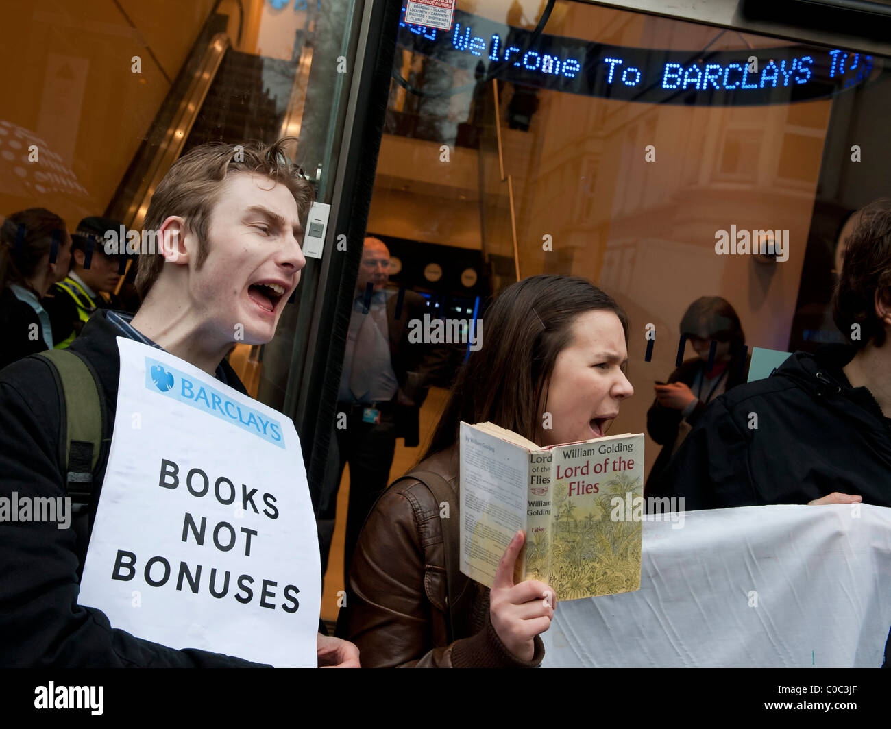 UK Uncut organise a protest against Barclays Bank in London, closing several branches, because they pay so little - Stock Image