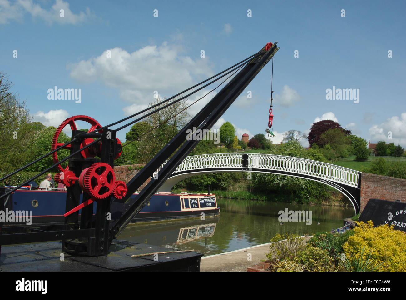 Ornate crane and the roving bridge at Braunston Marina, Northamptonshire, England UK - Stock Image