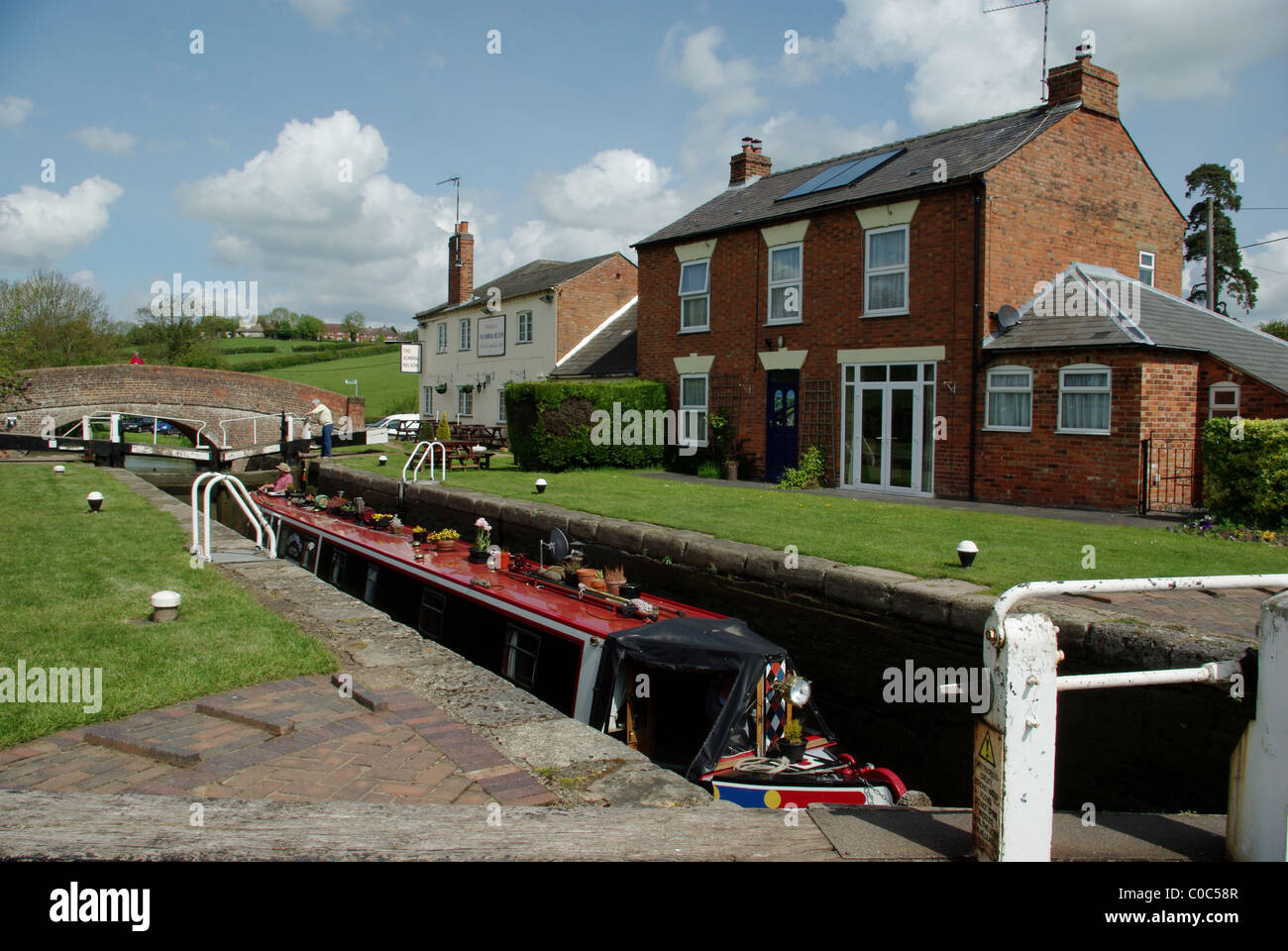 A narrowboat entering a lock on the Grand Union Canal at Braunston, Northamptonshire, England, UK - Stock Image