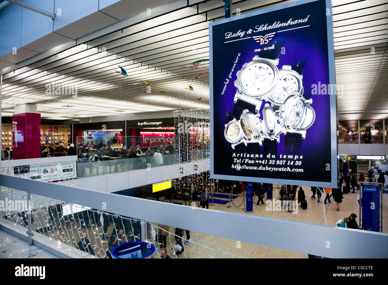 Main International terminal departure hall, Geneva / Geneve Airport, Switzerland. The airport is commonly known - Stock Image