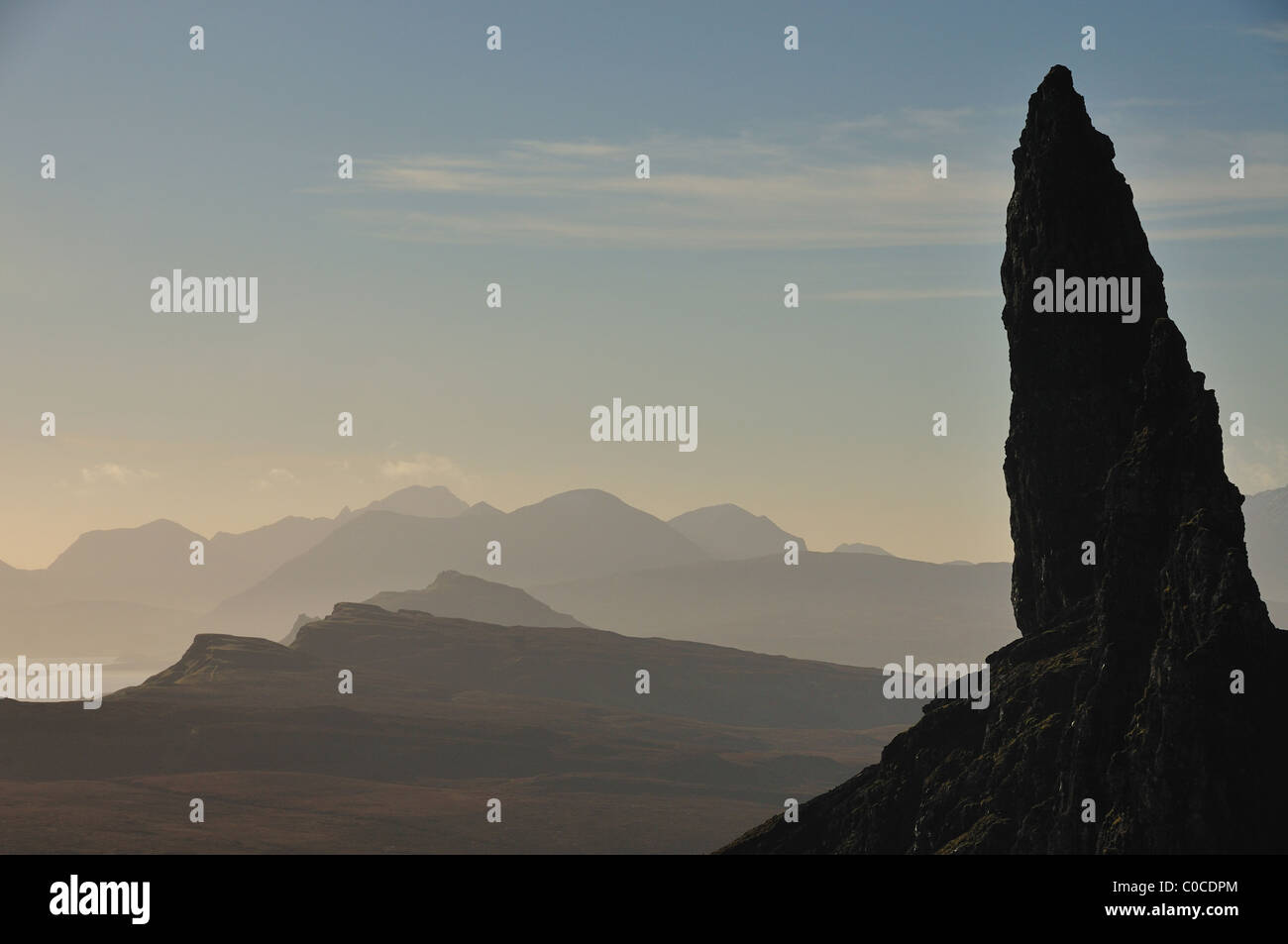 Close up silhouette of the Old Man of Storr, with the Cuillin mountains in the background, Isle of Skye - Stock Image