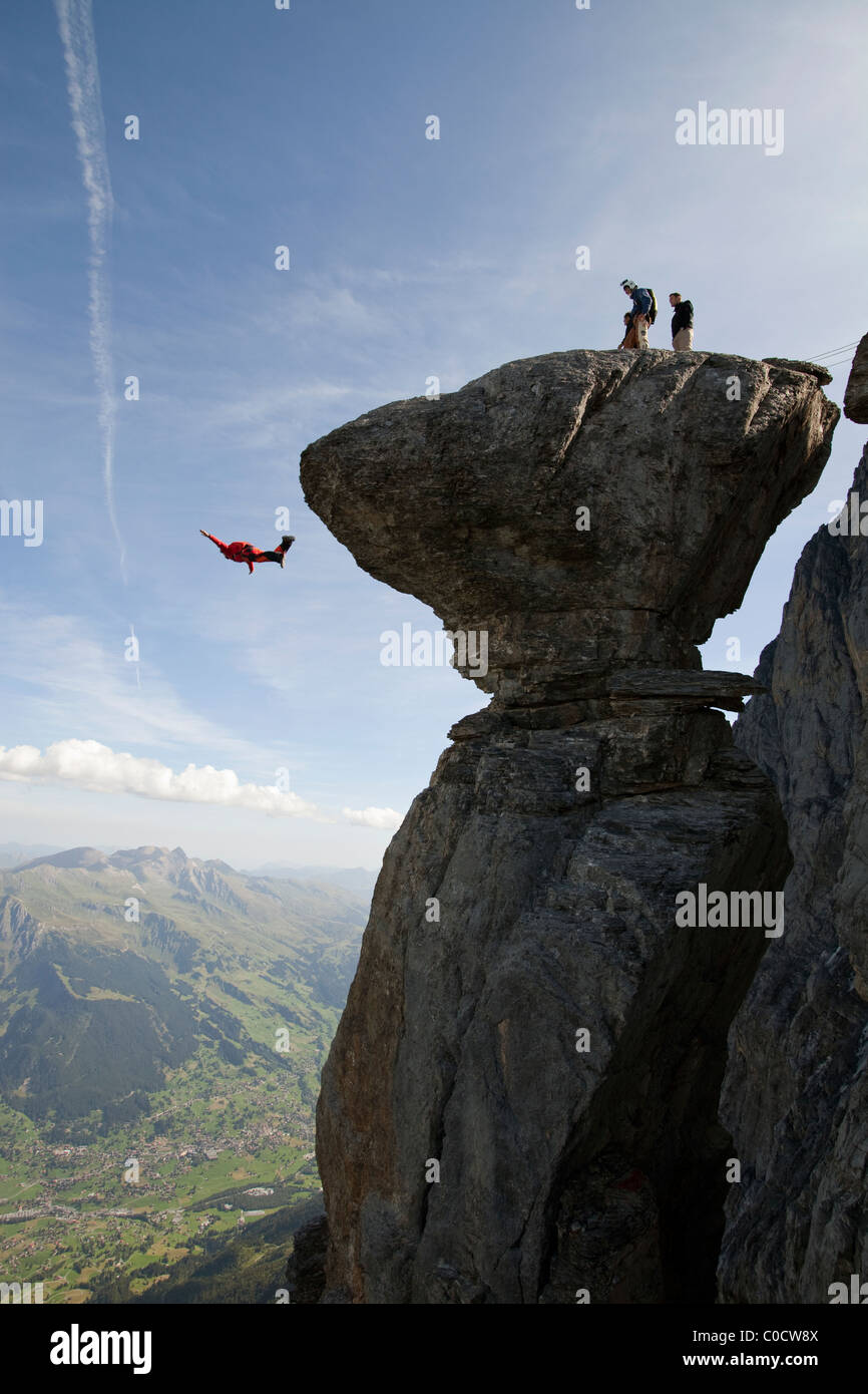 BASE jumper is diving from significant mushroom cliff. - Stock Image