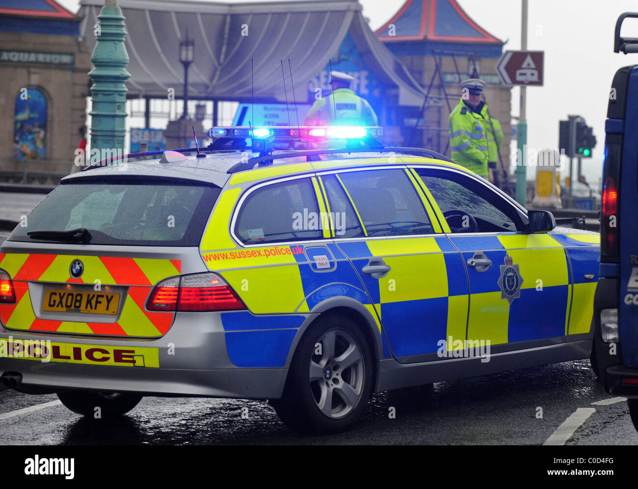 the blue light on top of a a police car flashing at the scene of a