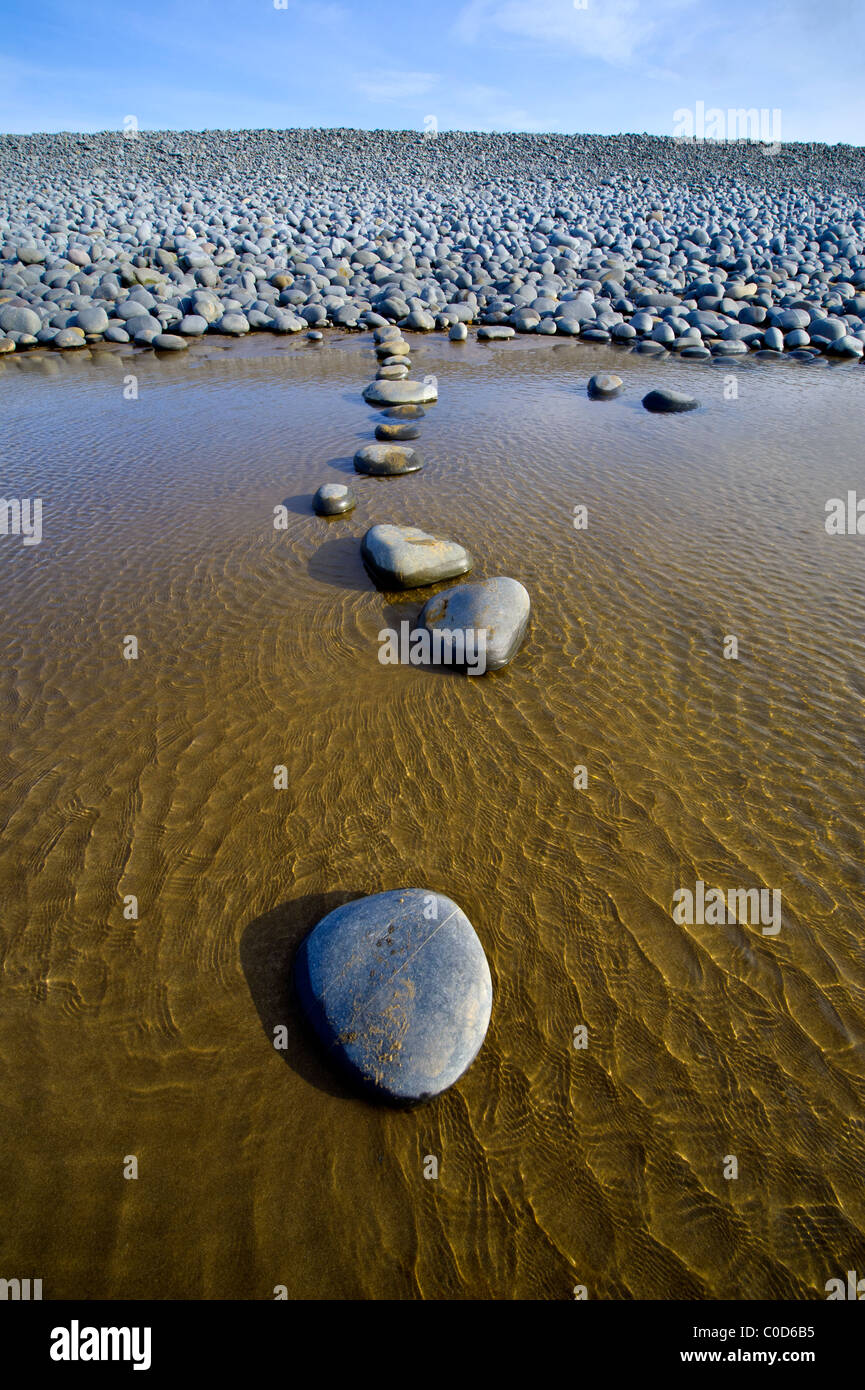 rounded pebbles stepping stones at Northam Burrows on the North Devon coast Stock Photo