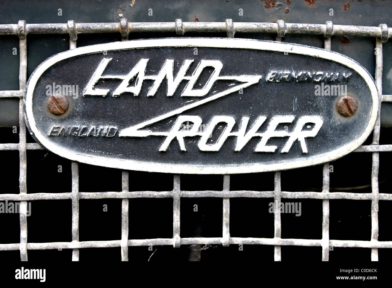 A Close Up Of The Land Rover Symbol Badge On The Front Grill Of A
