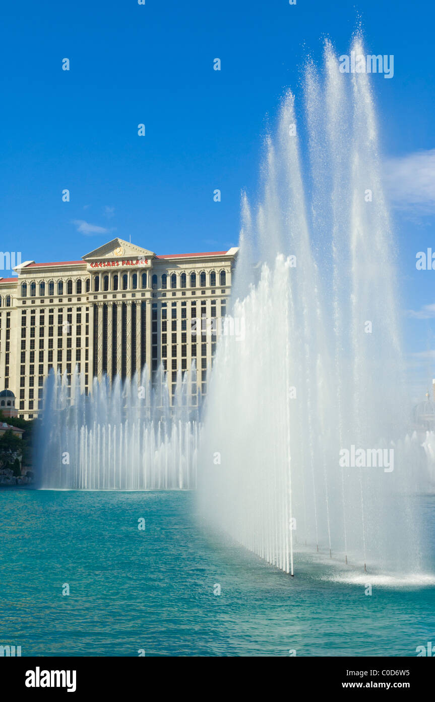 Water fountains and rainbow outside the Bellagio hotel with Caesars Palace hotel behind, The Strip, Las Vegas Nevada - Stock Image