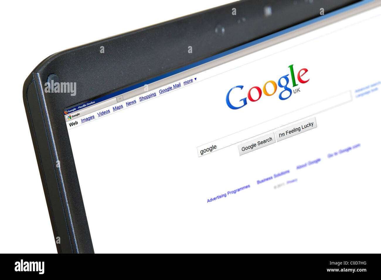 Performing a Google search on a laptop computer, UK - Stock Image