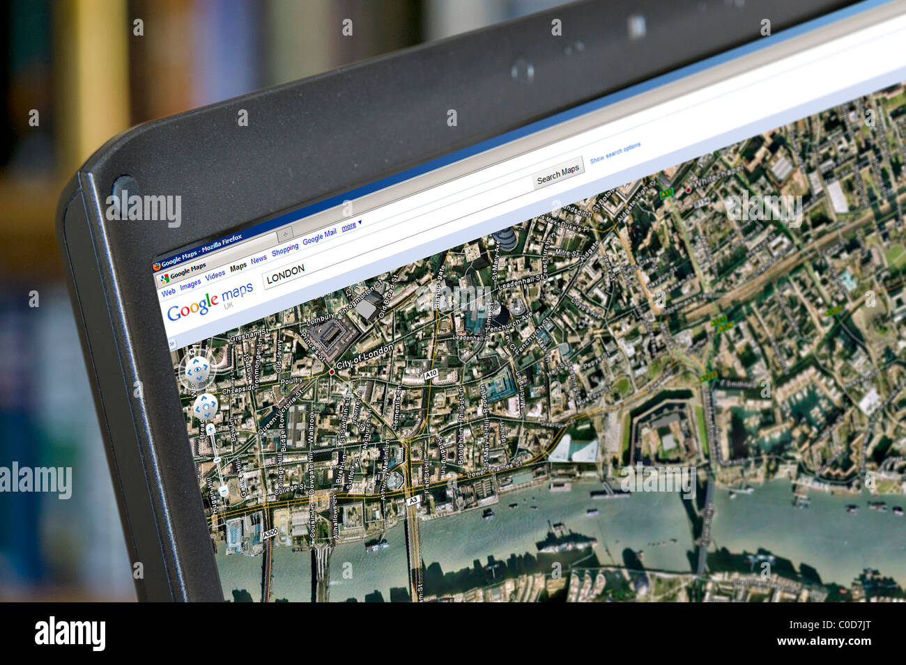 google earth view of london on google maps on a laptop computer uk