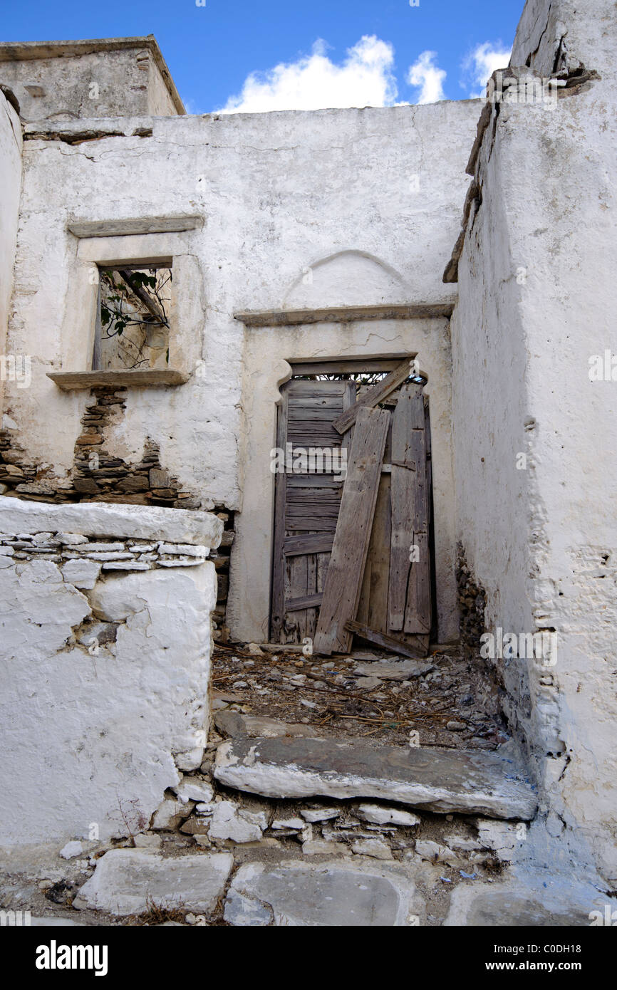 Doorway of an old abandoned house in the village of Lefkes, on the Greek Cyclade island of Paros. - Stock Image