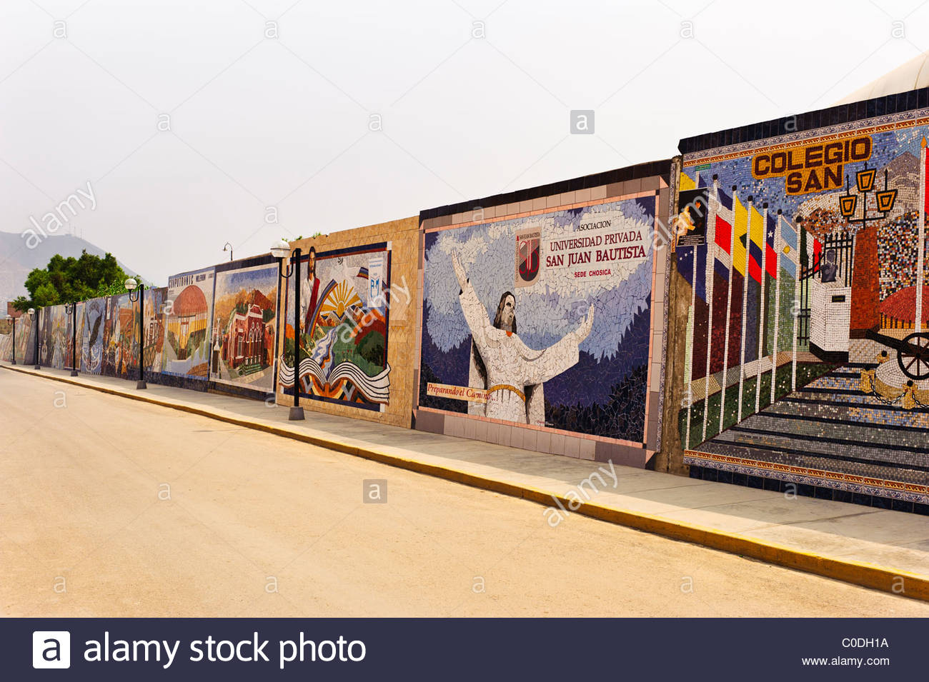 Signage created out of mosaic tiles adorns a wall in Chosica, Peru. - Stock Image