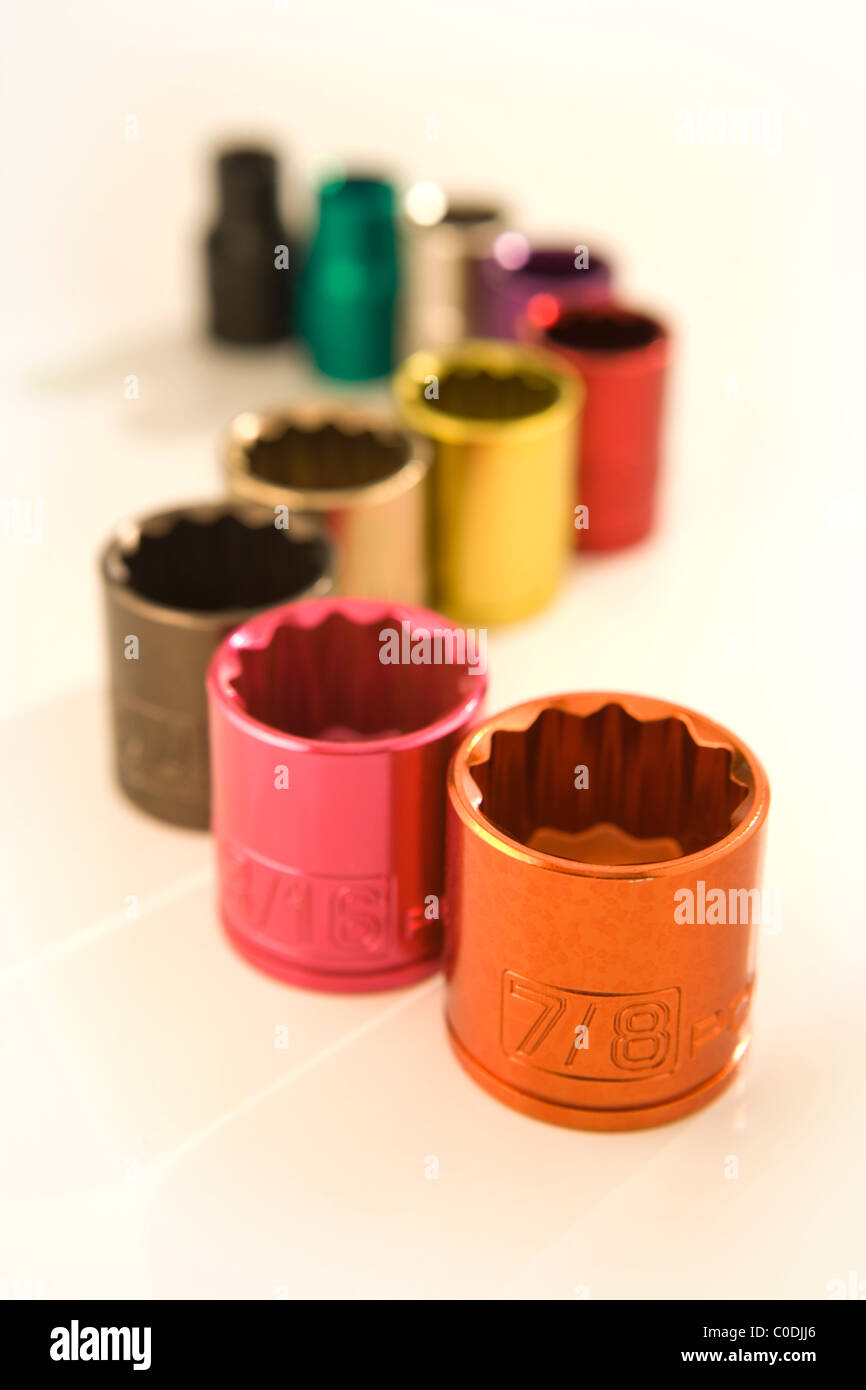 Color coded metal sockets from a socket wrench set - Stock Image