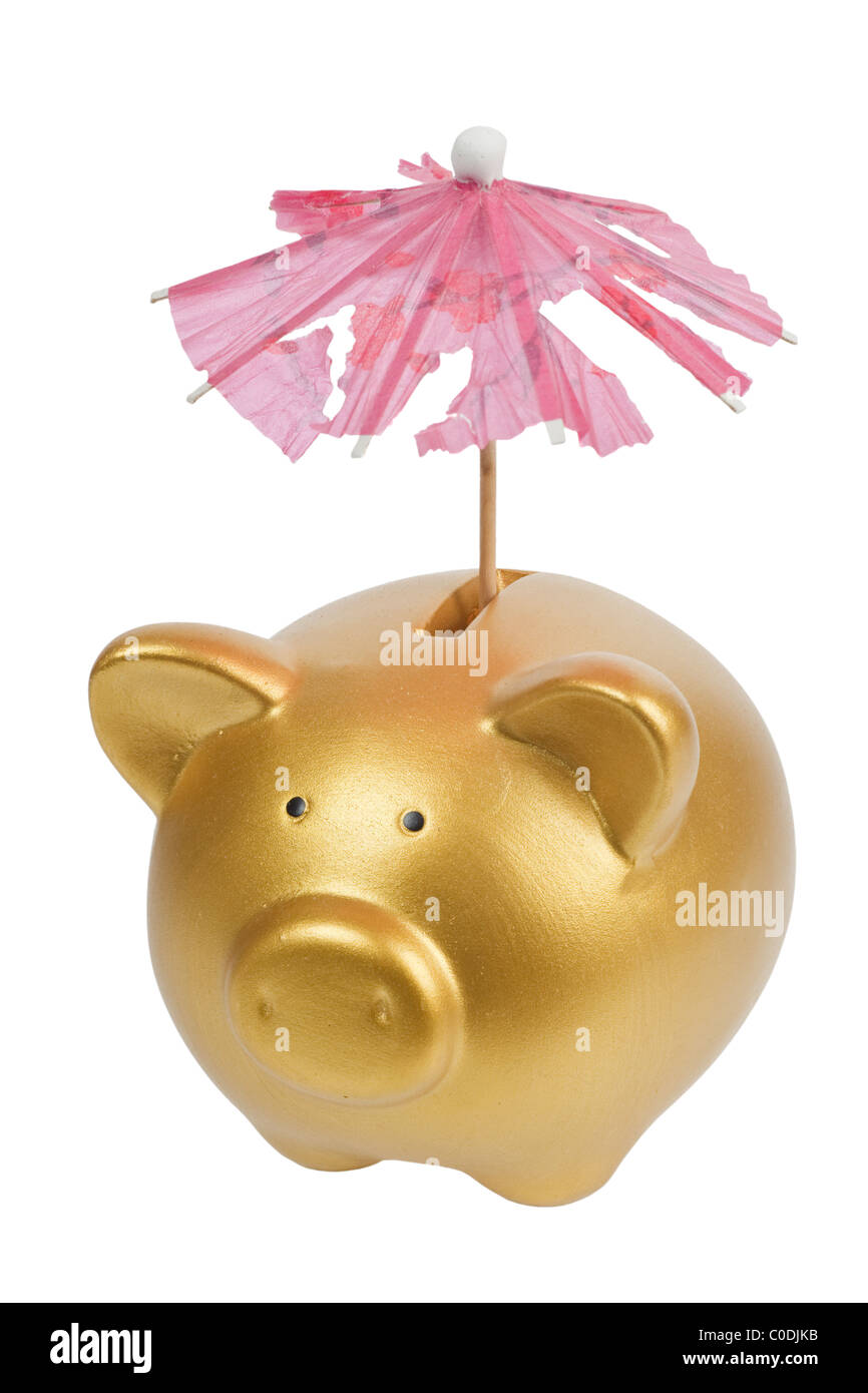 Gold piggy bank with tattered umbrella isolated pon white background - Stock Image