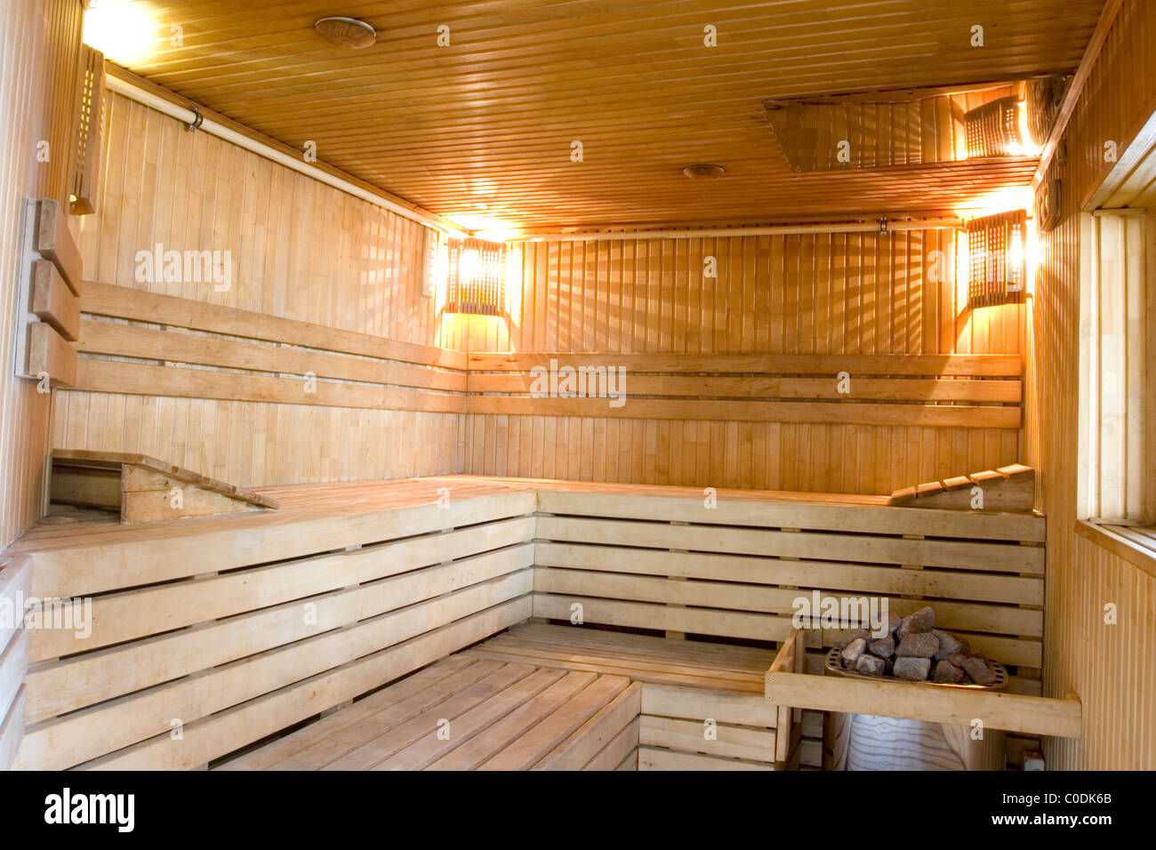 Sauna with furnish from a natural tree and stones for steam creation. - Stock Image