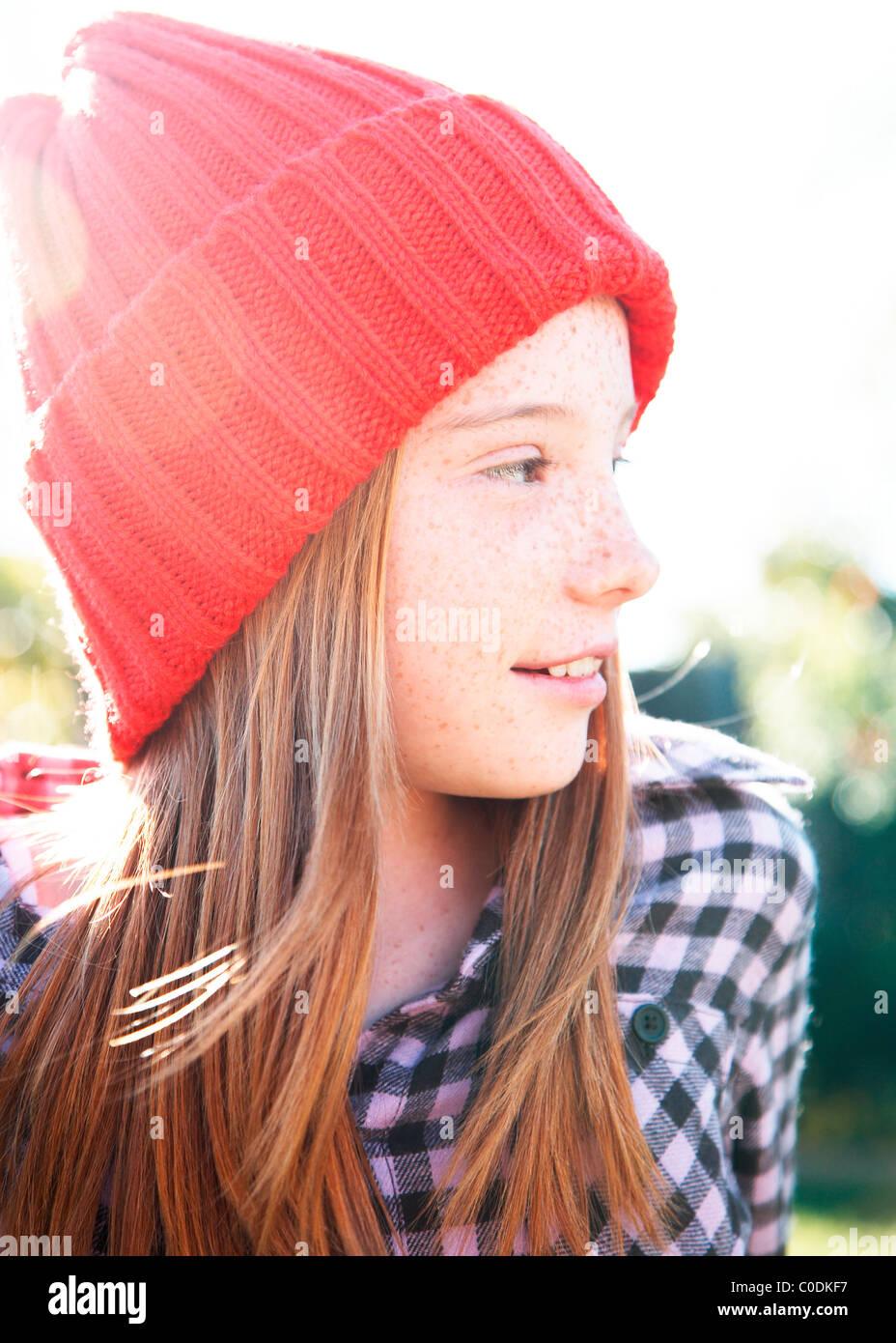 Girl wearing red stocking hat - Stock Image
