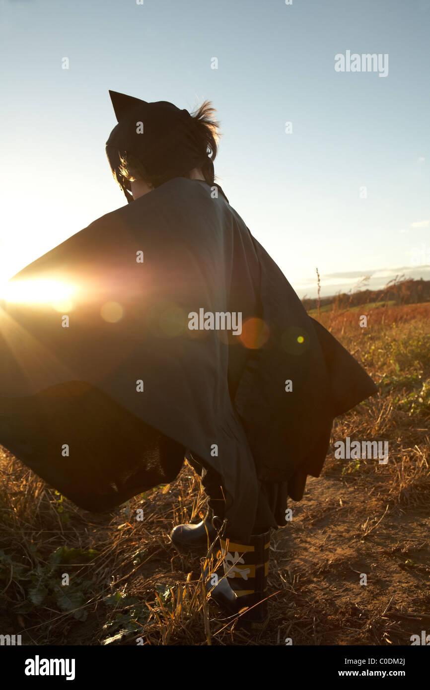 Child in superhero cape - Stock Image