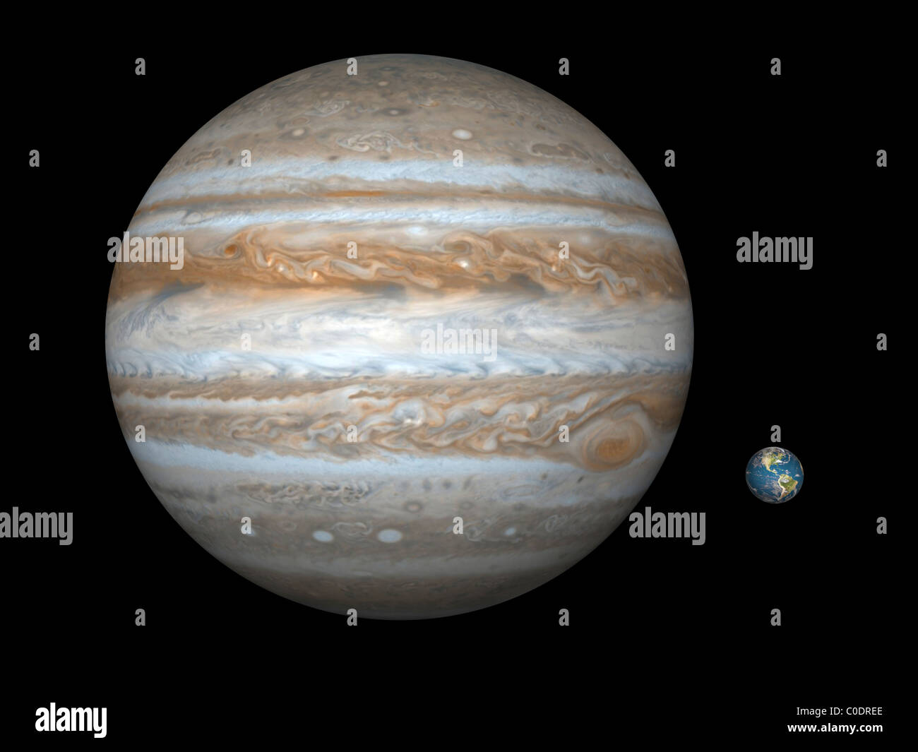 Artist's concept comparing the size of the gas giant Jupiter with that of the Earth. - Stock Image