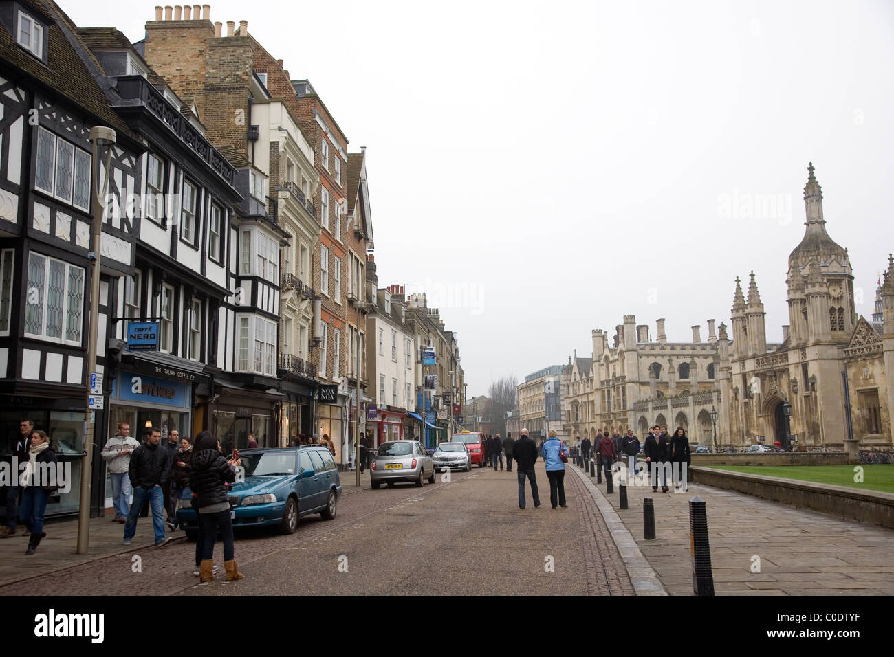 Kings Parade shops with Kings College Gatehouse to the right - Stock Image