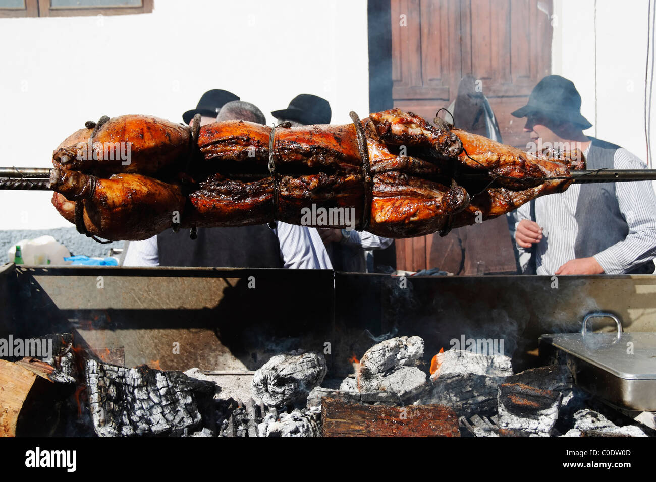 Whole pig roasting on barbecue at Fiesta del Almendro in Tejeda, Gran Canaria, Canary Islands, Spain Stock Photo