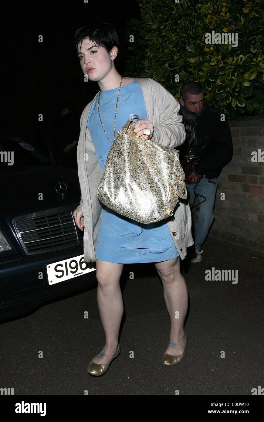 Kelly Osbourne is escorted out of the back door of Mahiki nightclub by two doormen after photographers had been told by a  sc 1 st  Alamy & Kelly Osbourne is escorted out of the back door of Mahiki nightclub ...