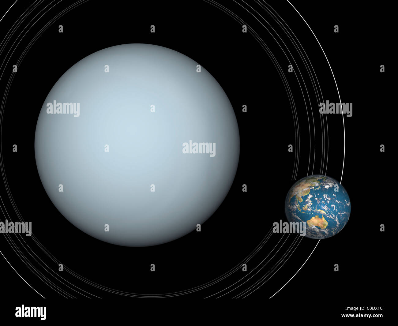 Artist's concept of Uranus and Earth to scale. - Stock Image