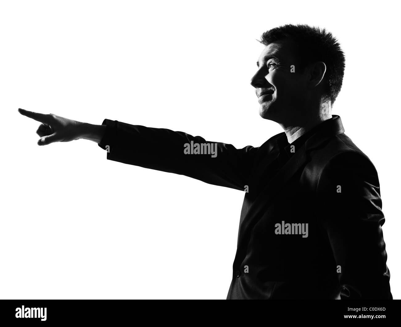 silhouette caucasian business man expressing pointing mocking sneering behavior full length on studio isolated white - Stock Image