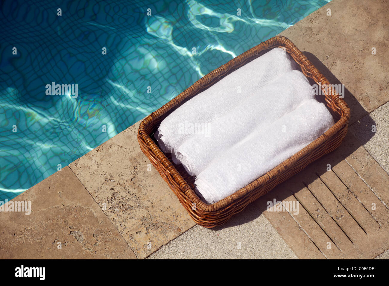white towels in basket by swimming pool Stock Photo ...