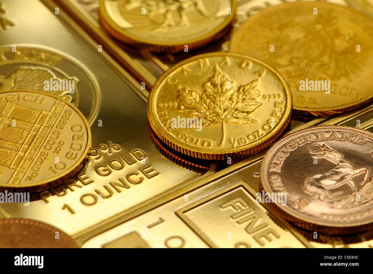 Gold Bullion - 1oz bars and small coins - Stock Image