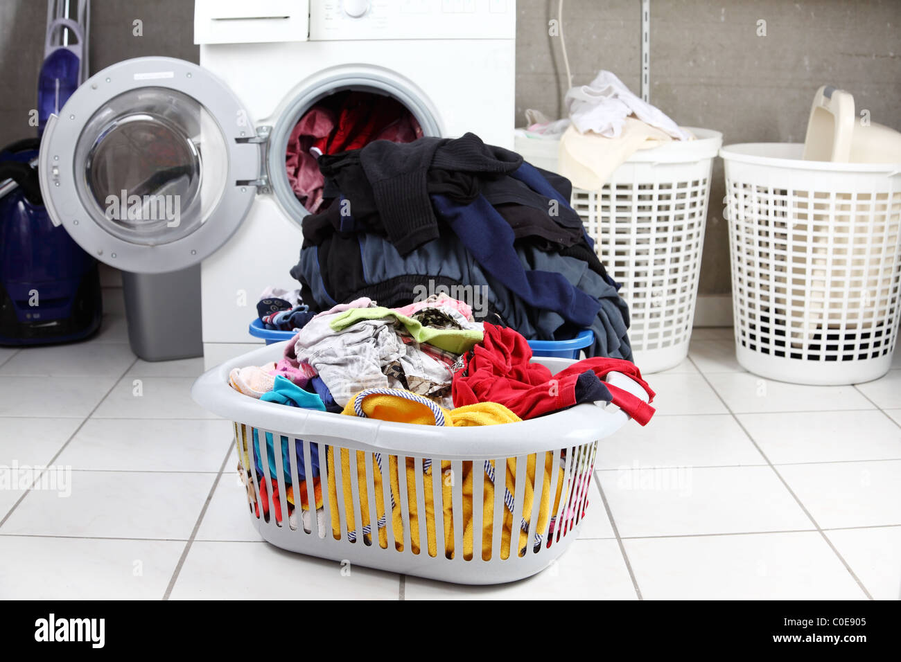 Two baskets of dirty laundry in the washing room - Stock Image