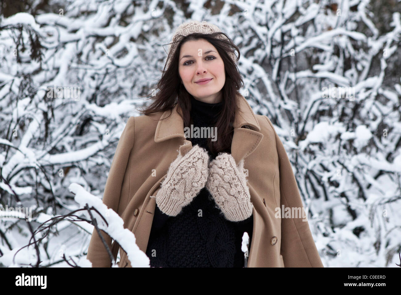 Portrait of a young woman in the snow Stock Photo