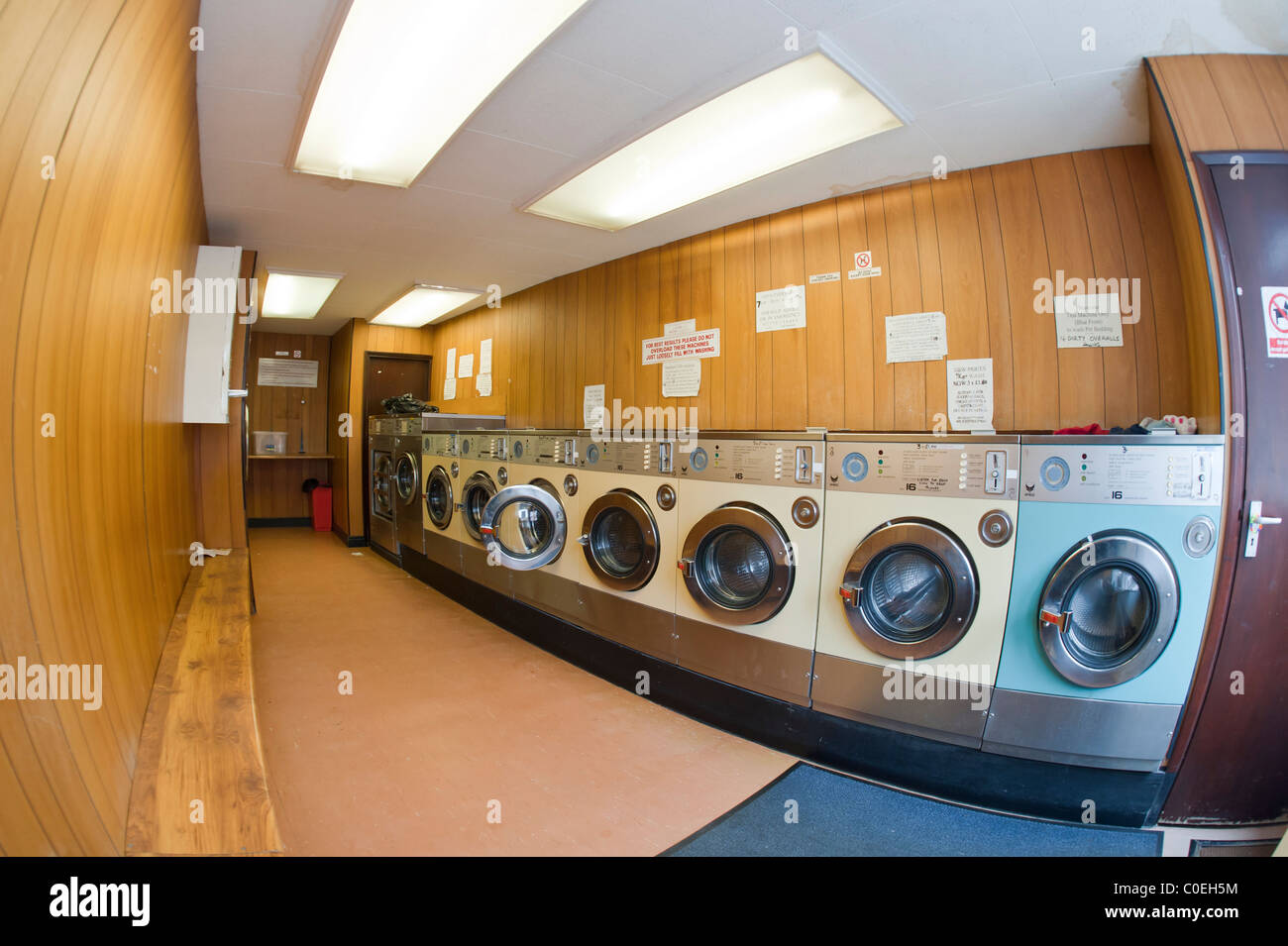 A laundrette with commercial washing machines in the Uk - Stock Image
