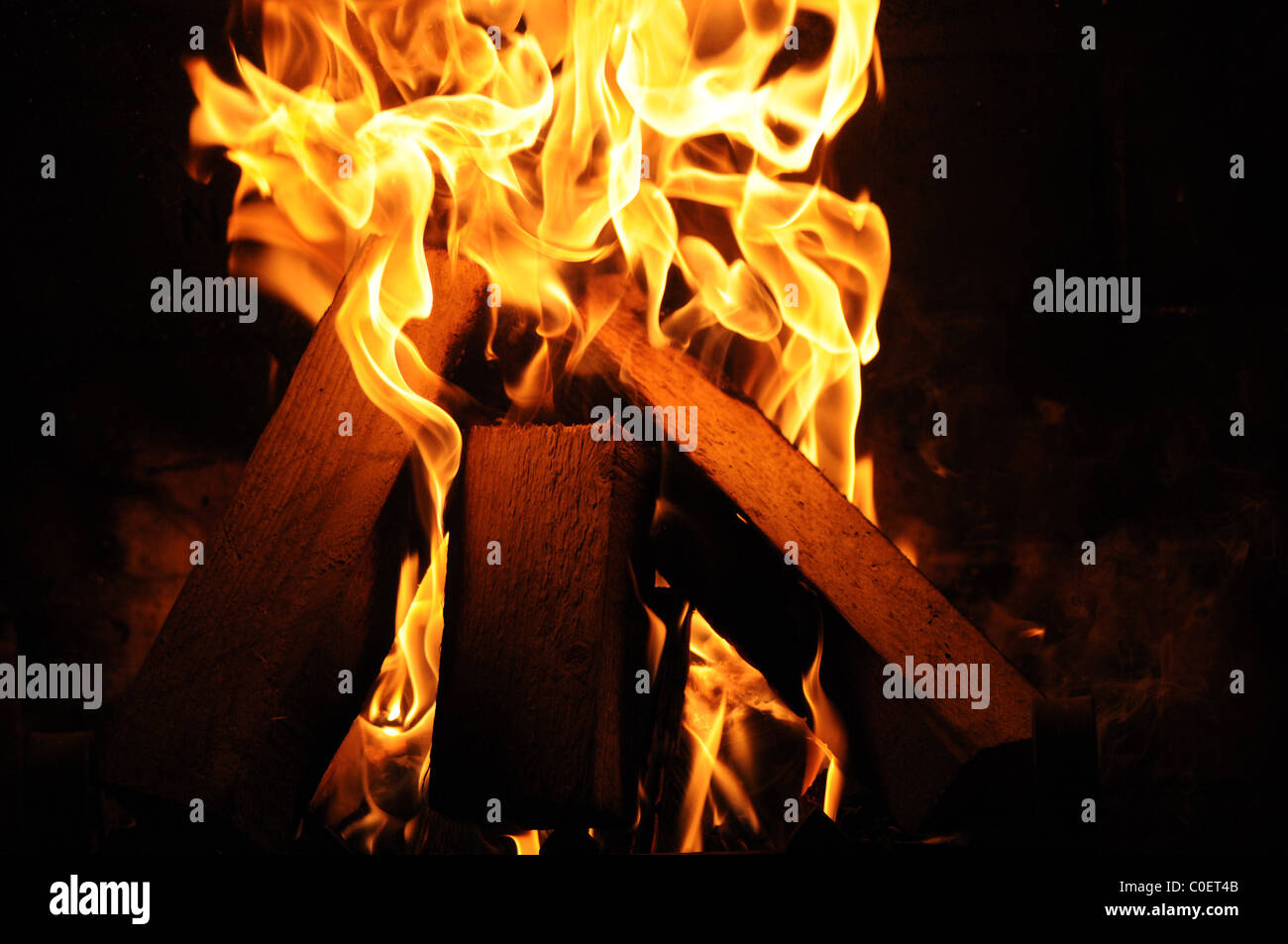 Log Fire seen burning in farm house,creating a feeling of warmth and comfort in cold winter months. Stock Photo