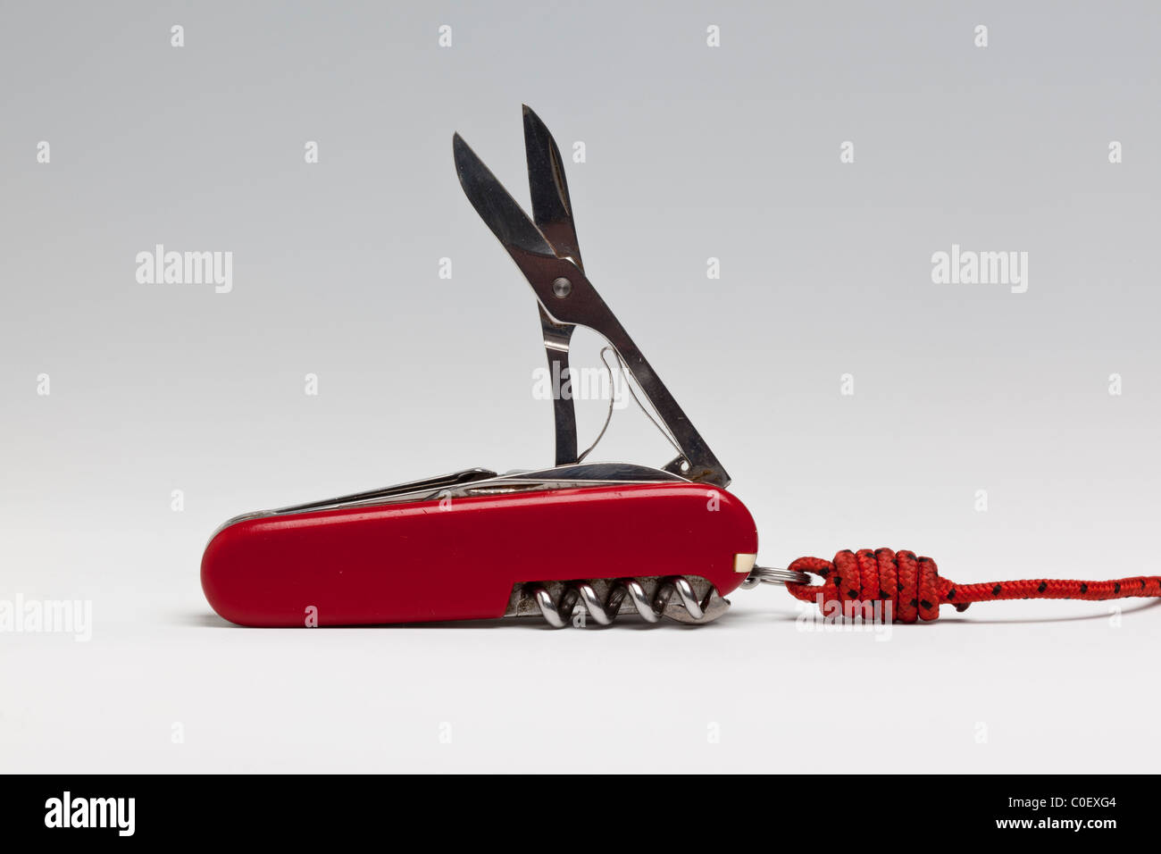 Swiss Army Knife, attached to a cord using a blood knot - Stock Image