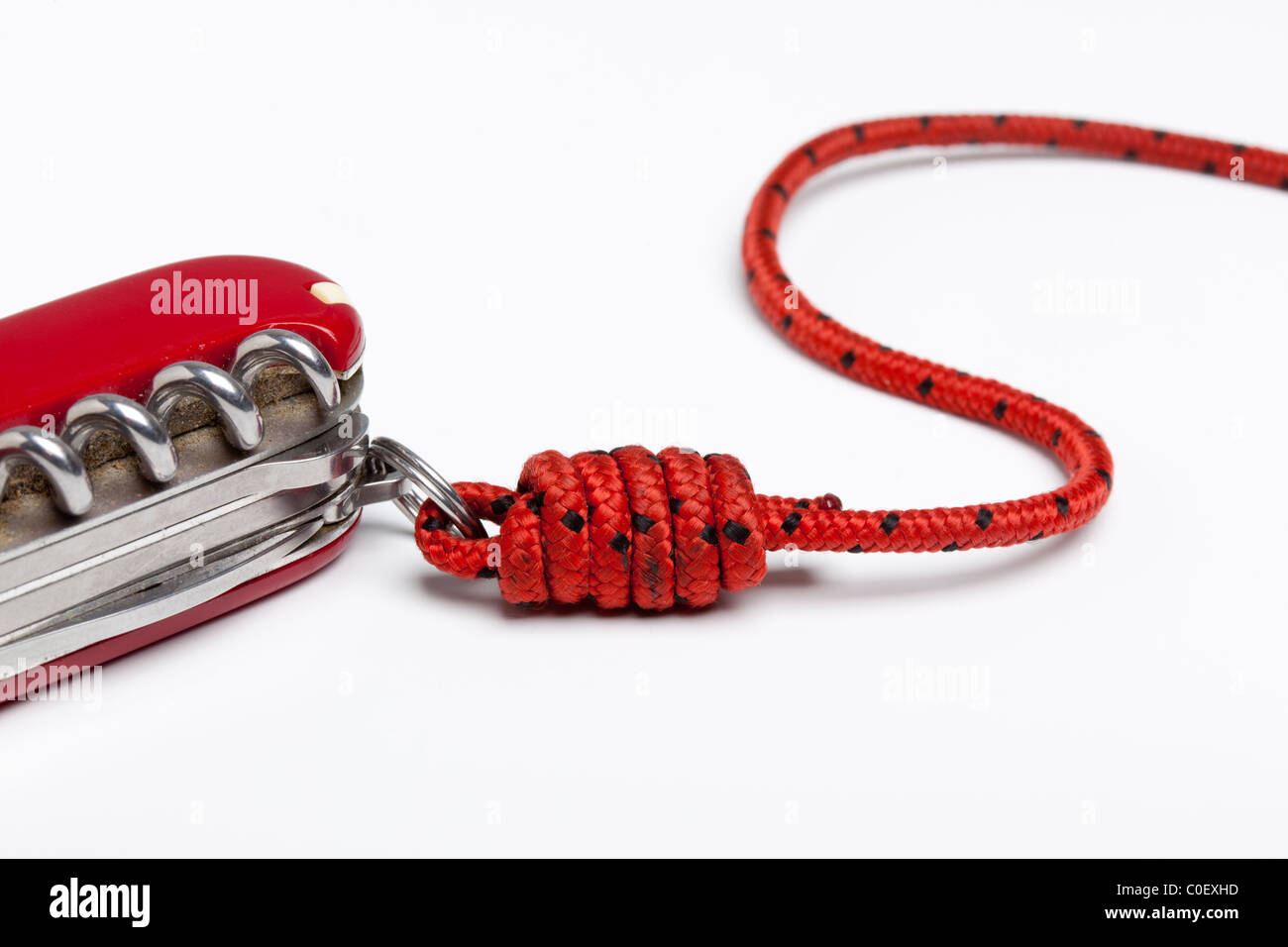 Old Swiss Army Knife, attached to a cord using a half blood knot - Stock Image