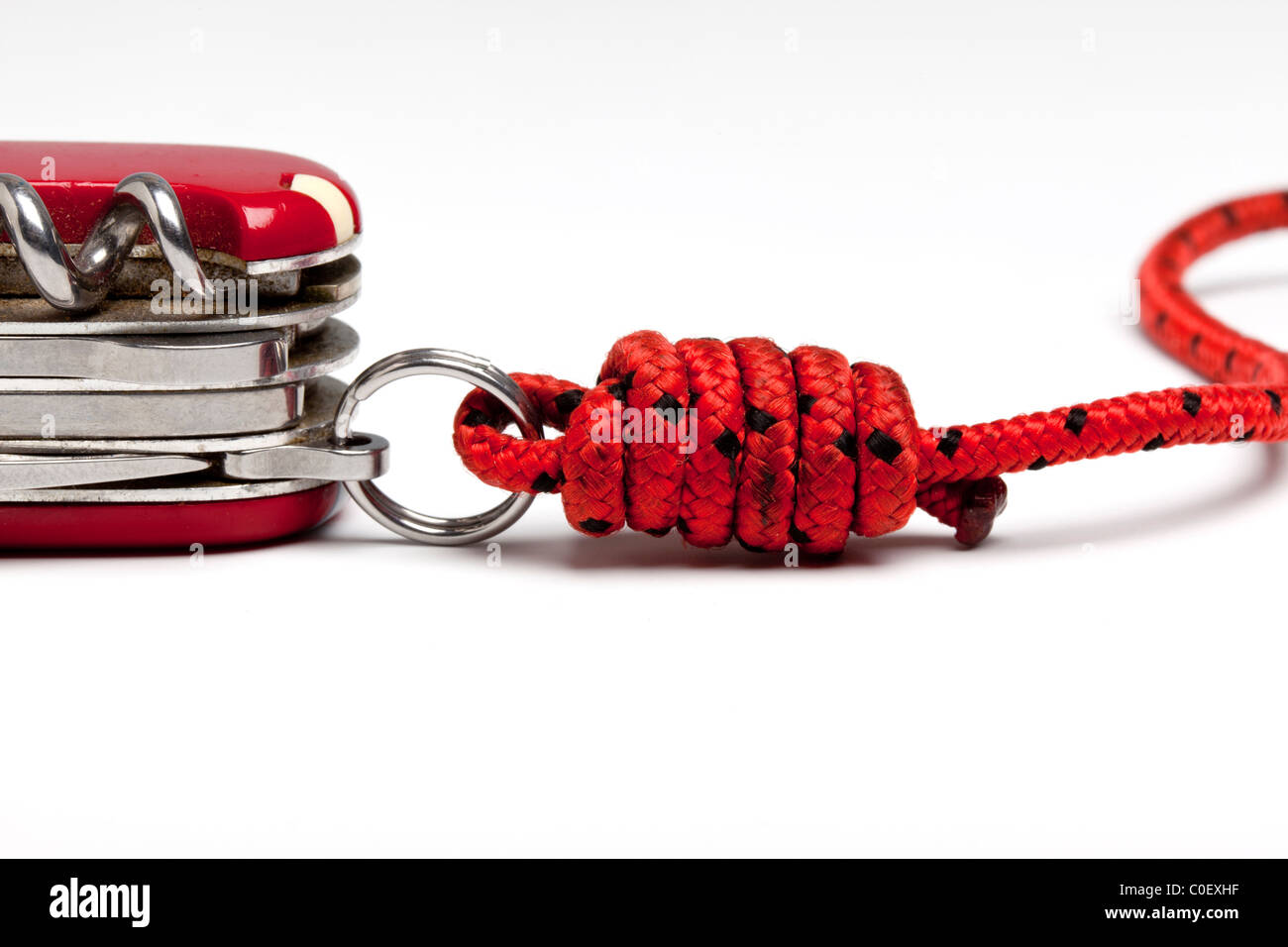 Swiss Army Knife, attached to a cord using a half blood knot. - Stock Image