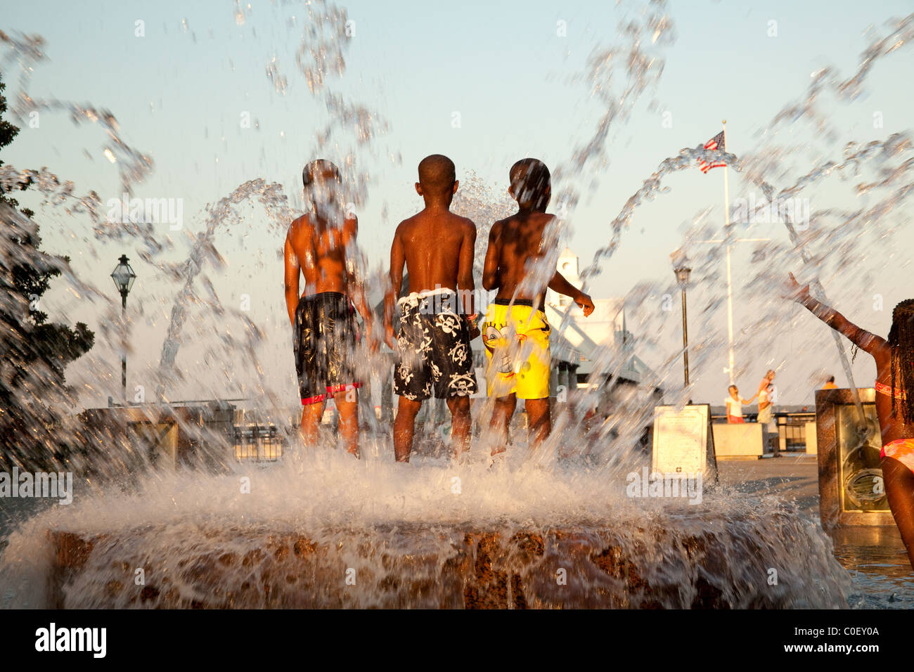 African-American children playing in fountain in Charleston's Waterfront Park in South Carolina USA - Stock Image
