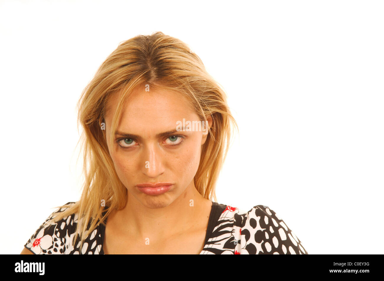 Spoiled young woman pouting - Stock Image