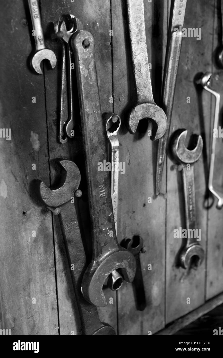Spanners hanging on aboard - Stock Image
