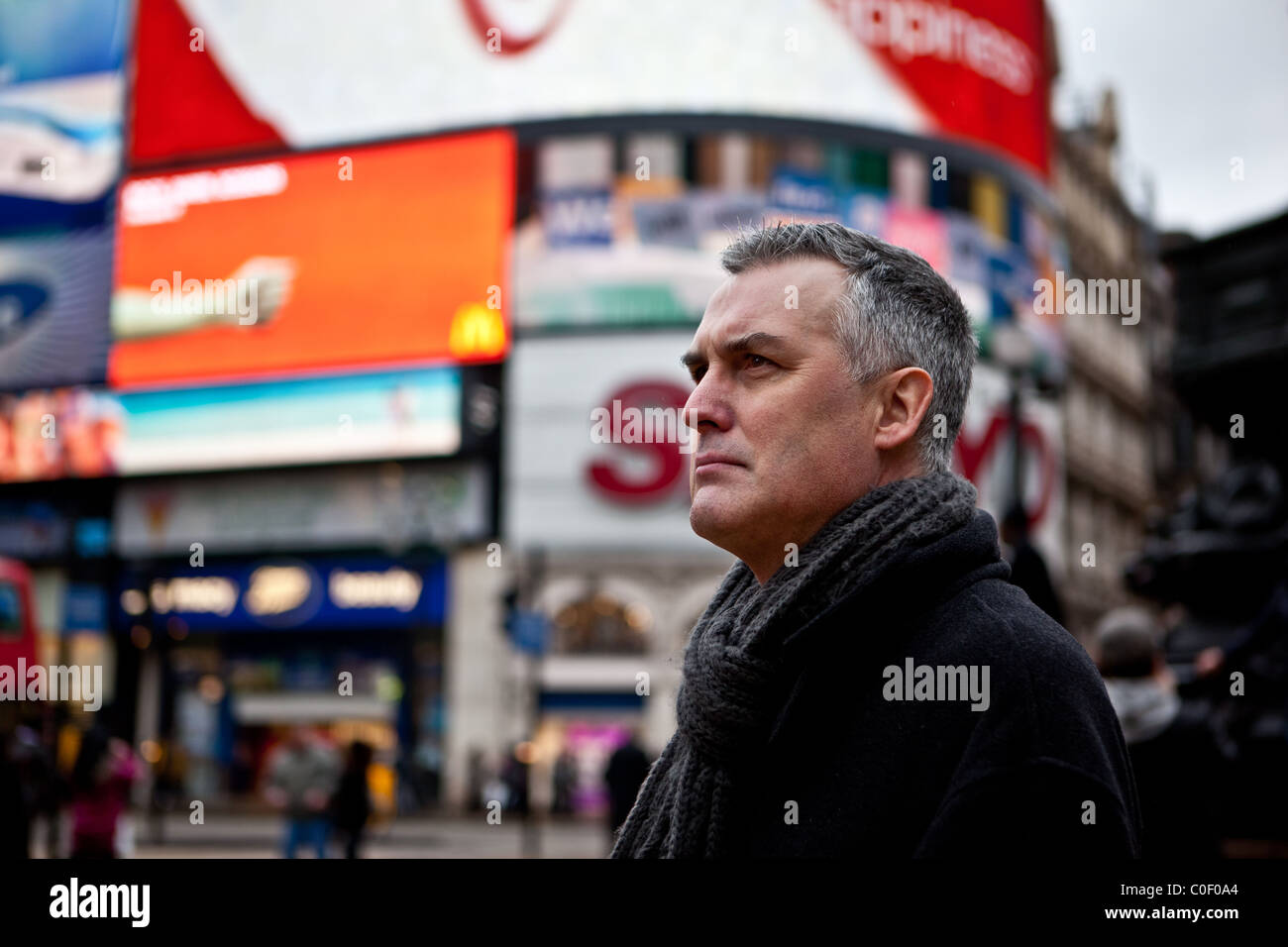 Stern Male in London's Picadilly Circus - Stock Image