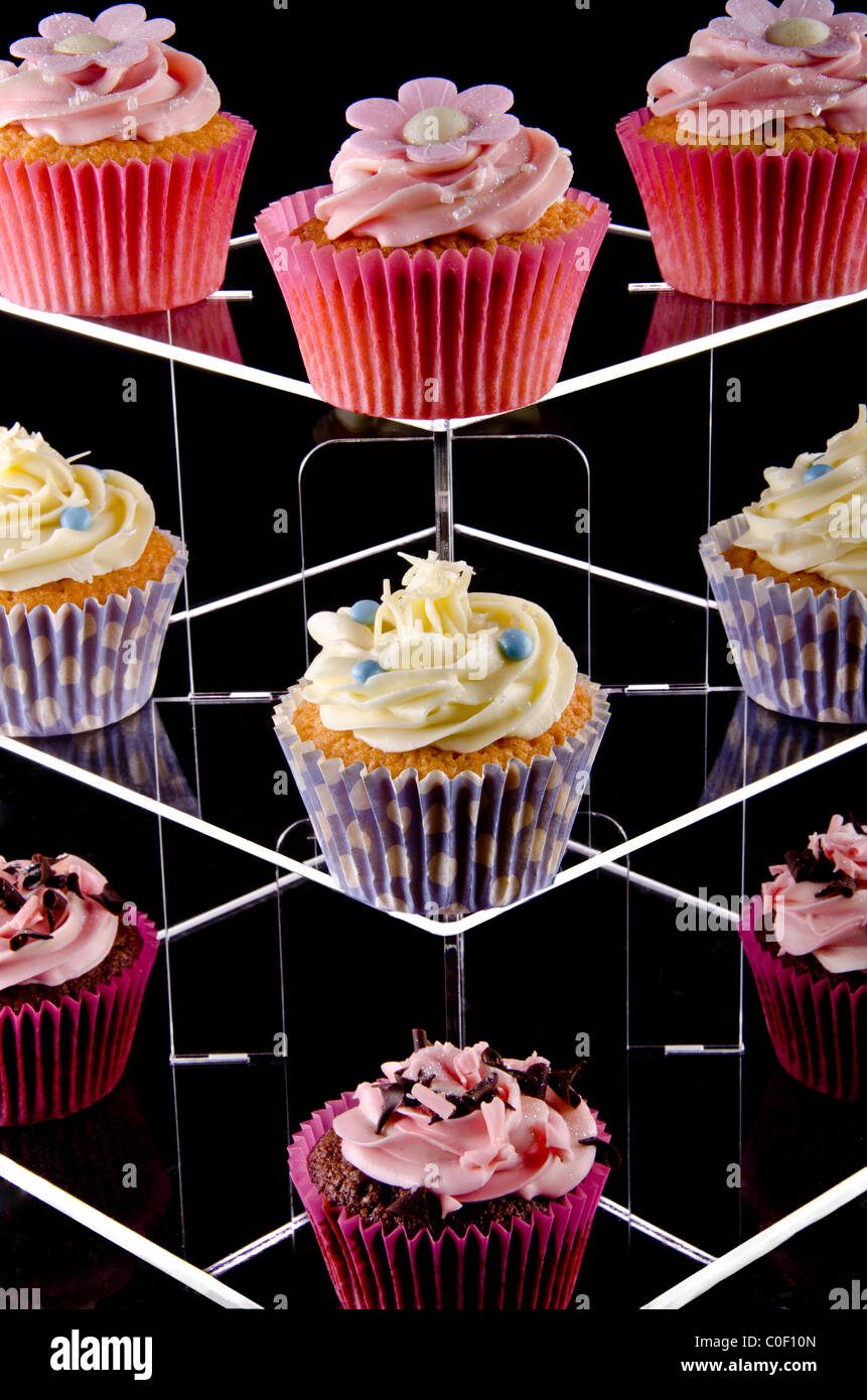 Cup Cakes Illuminated on a  Tiered Glass Stand - Stock Image