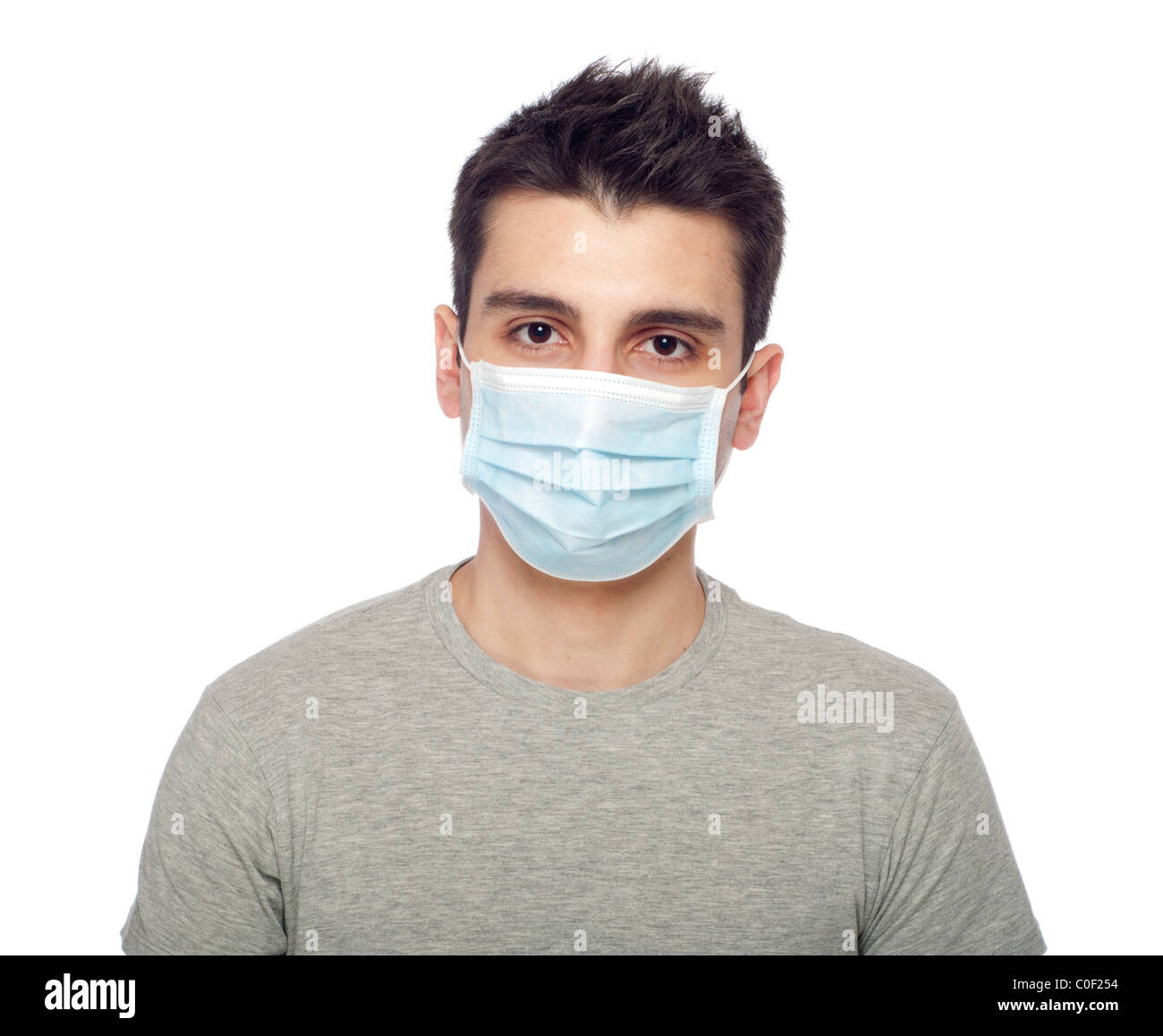 young man wearing a protective mask isolated on white background - Stock Image