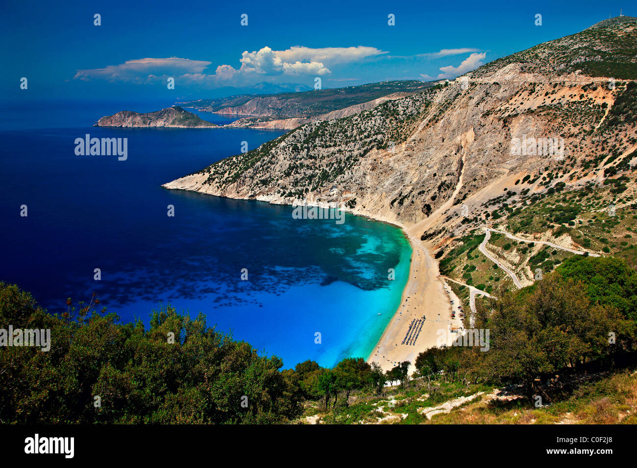 World famous Myrtos beach in Kefalonia island. In the background in that small peninsula you can see Assos village. - Stock Image