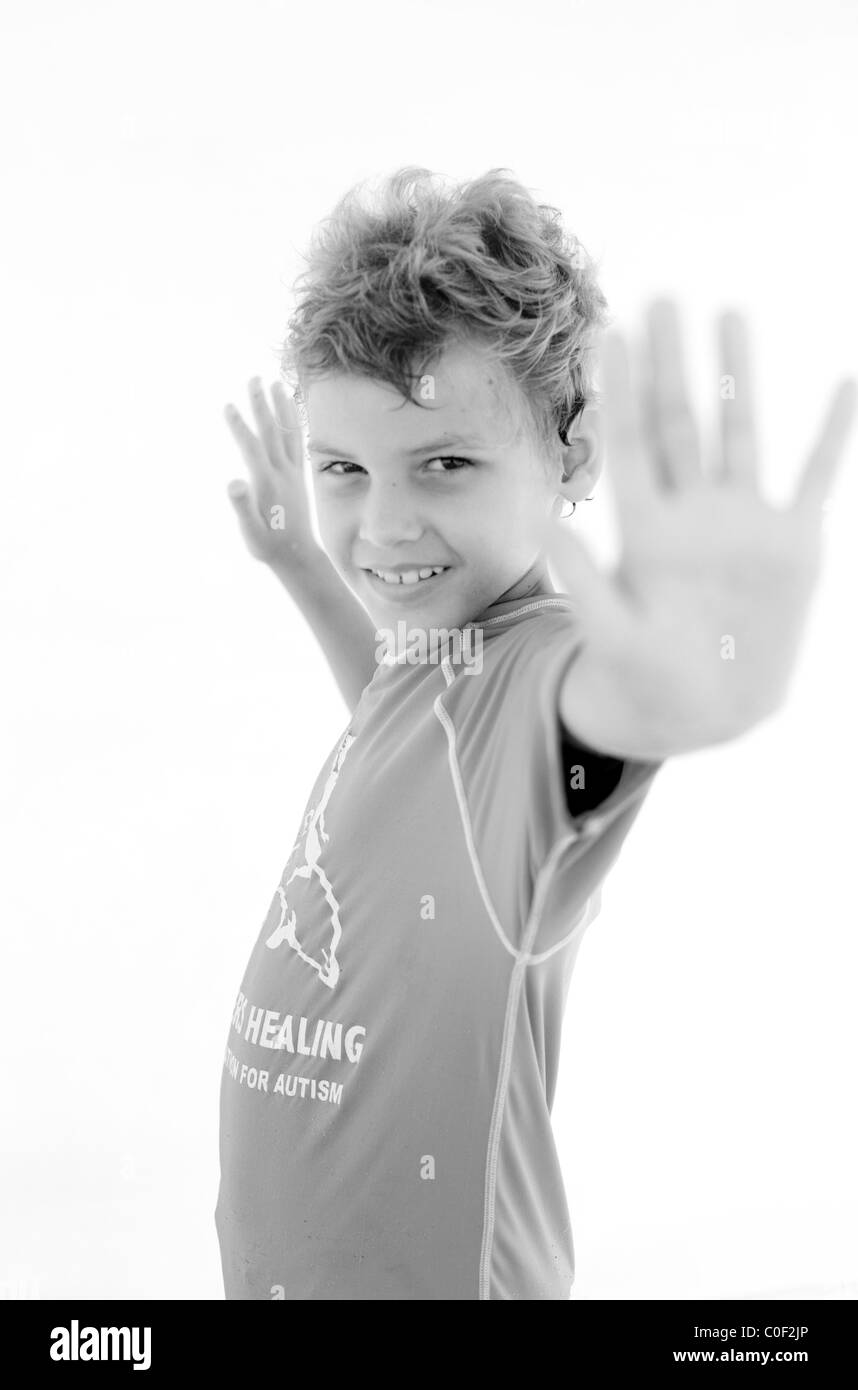 Portrait of child participant in Surfer's Healing, a camp for children with autism held in Wrightsville Beach, - Stock Image
